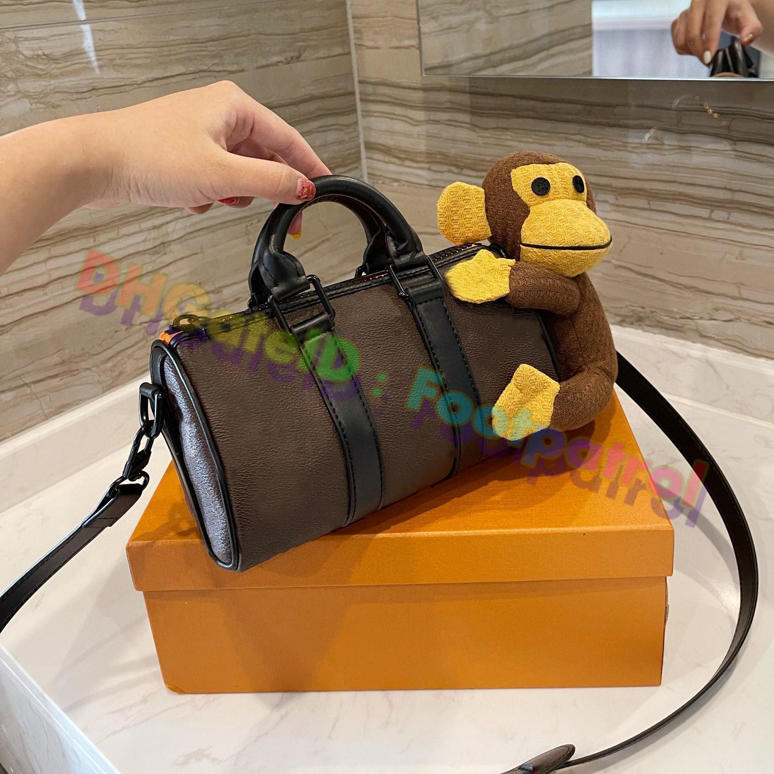 2021 الكلاسيكية وسادة أكياس القرد أحدث برميل شكل حقيبة جلدية خمر حقائب الكتف مصممي المصممين حقيبة يد الأزياء الصليب الجسم أعلى جودة محفظة محفظة