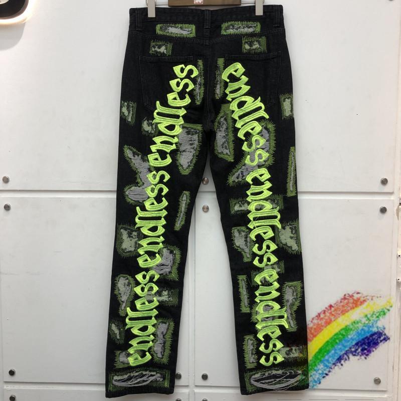 Jeans Endless Damage Hole Afligido Jean Homens Mulheres Fluorescente Letra Verde Letra Bordado Calças Denim