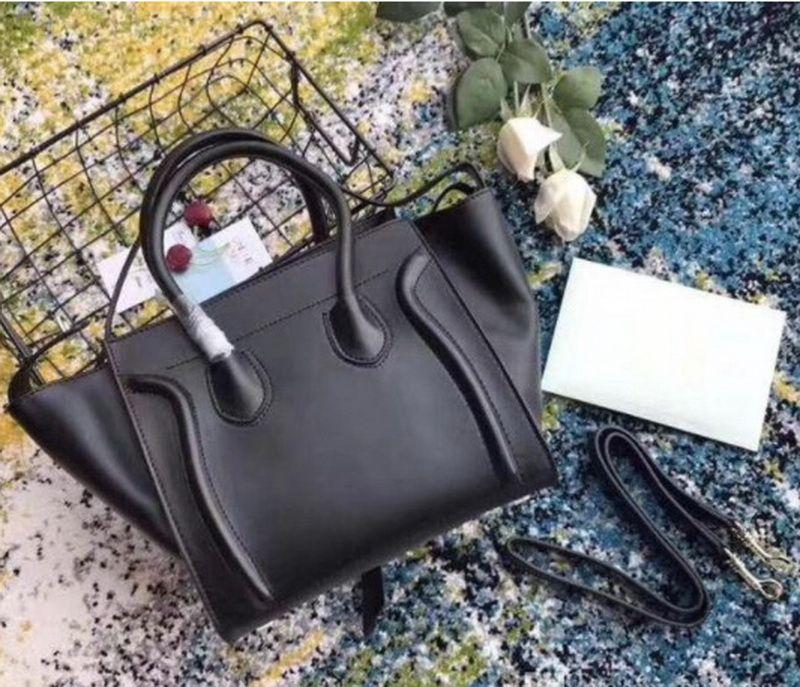 Classic Luxury Ladies Trapeze Casual Tote Real Cowhide Bag Bolsa de cuero Diseñador Hombro Bolso Bolso con bolso de muñeca Boston