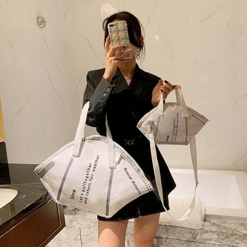 대용량 핸드백 캐주얼 여성 캔버스 토트 백 크리 에이 티브 호보 마스크 어깨 가방 여성 패션 트렌디 한 숙녀 구매자