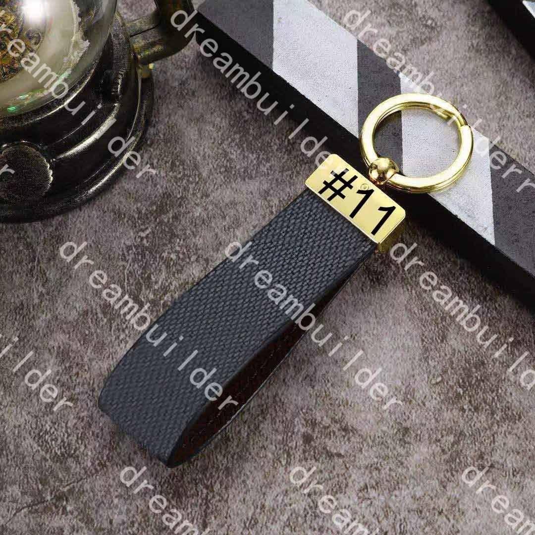 M65221 럭셔리 패션 디자이너 스트랩 수제 PU 가죽 자동차 키 체인 여성 가방 매력 펜던트 액세서리