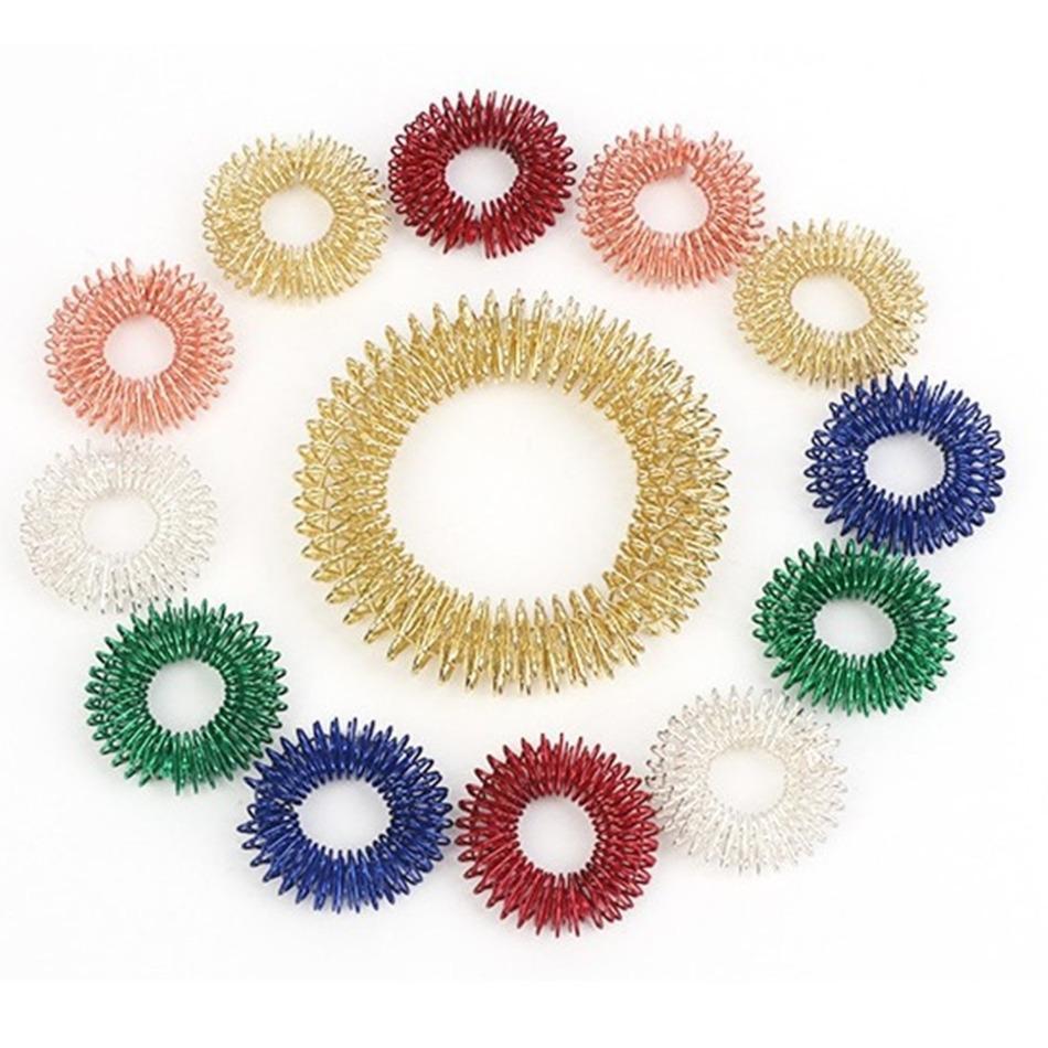 Fidget Sensory Toy Ring Massager Spiky Anillos de dedo Alivio del estrés Squeeze Spinner Juguetes Dedos Diversión juego Estrés Relieve Adhd Auti HH314TZD