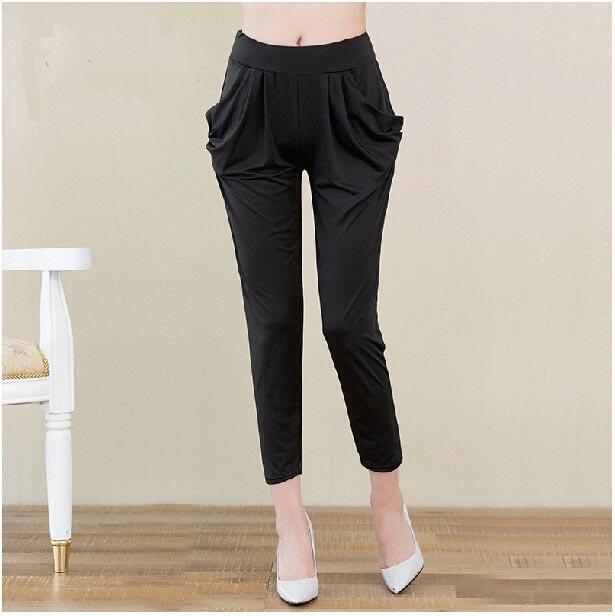 Las mujeres del otoño de alta calidad ocasionales flojas de cintura alta pantalones elásticos del harén Capris sólidos