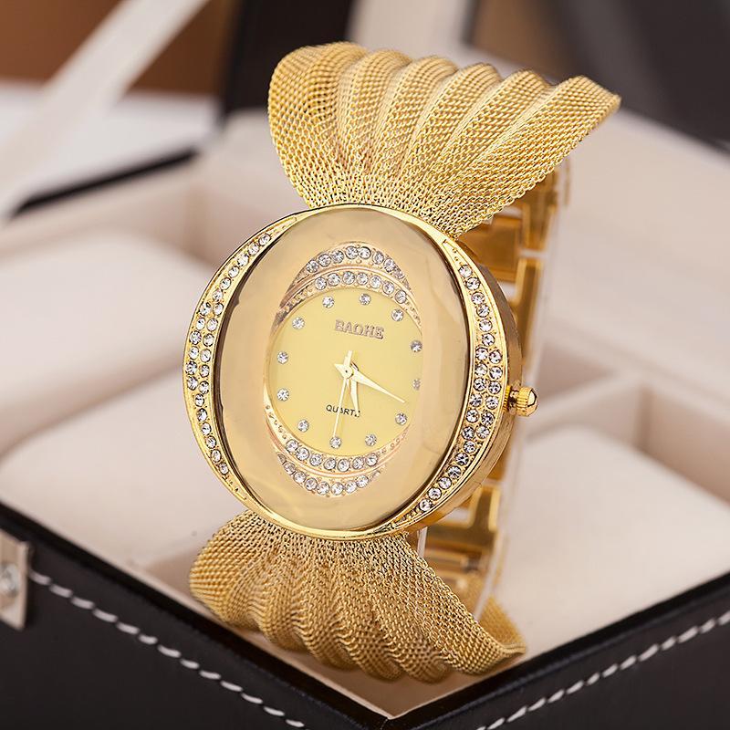 les femmes s'habillent montres à quartz montre de luxe Mesh montre-bracelet ovale bracelet en or en alliage strass montres pour femmes en gros dame horloge