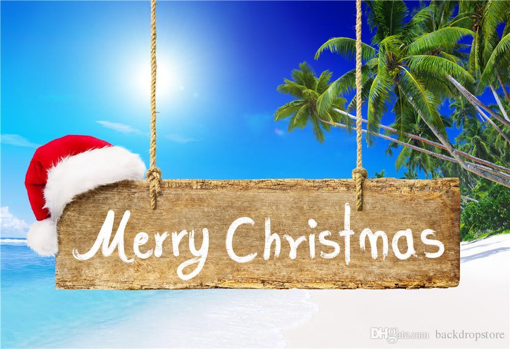 Playa Fotografía de vacaciones Fotografía Telón de fondo Tela de vinilo Cielo azul Árbol de coco Sombrero rojo Colgando Tablero de madera Feliz Navidad Foto de fondo