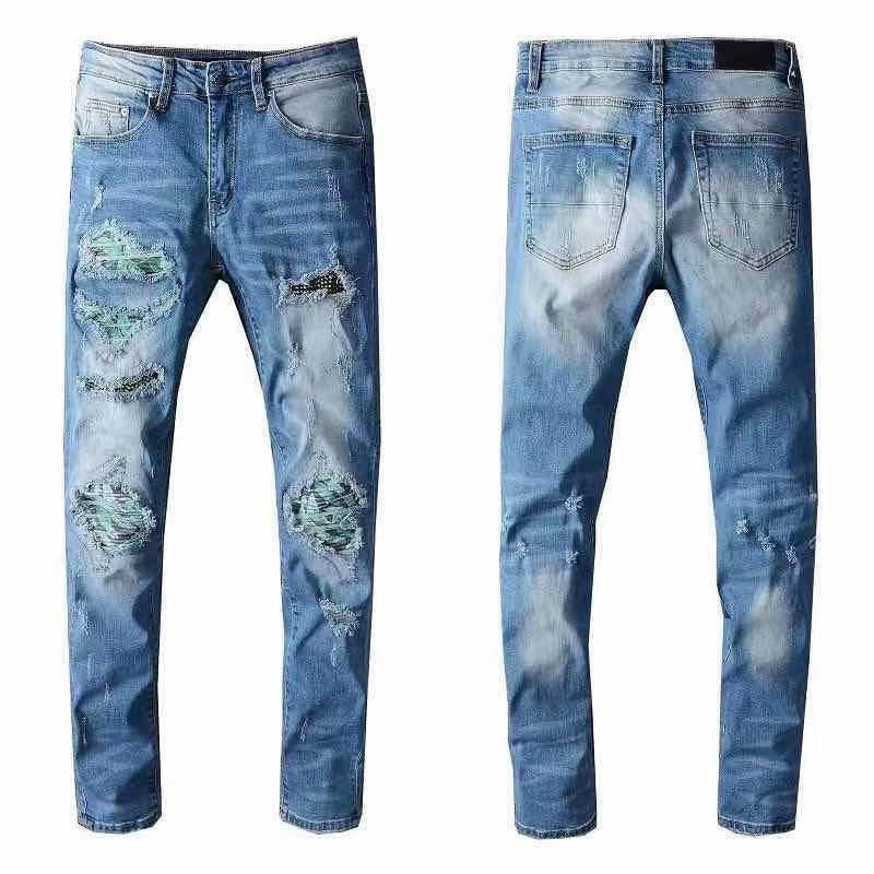 Европейские и американские летние джинсы моды HIP-HOP моды, моющиеся ретро порванные сгибающие сшивающие мужские дизайнерские мотоцикла тонкие брюки.