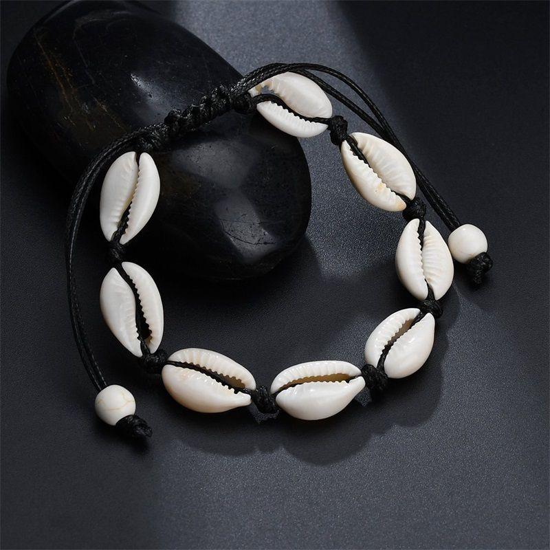 Shell Charm Bracelets Bohemian Hecho a mano Seashell Ajustable Cuerda trenzada Brazaletes Mujeres Mano Pulsera con cuentas Pulsera Joyería 1537 479 Q2
