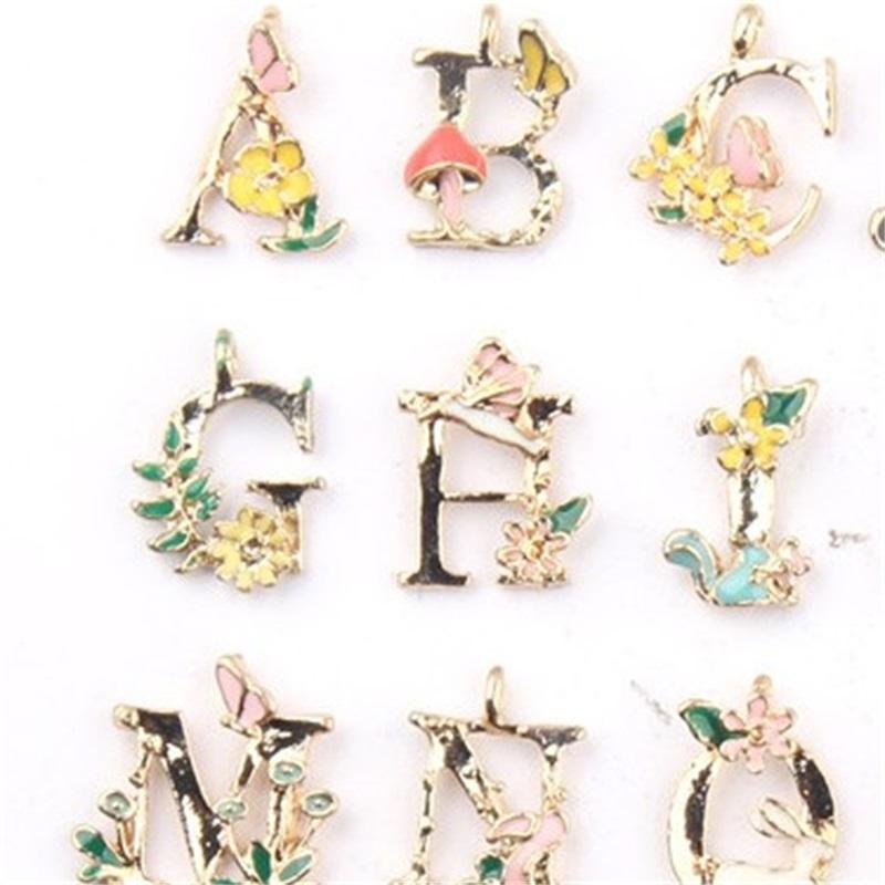 26 الإنجليزية إلكتروني سحر المعلقات مجوهرات diy قطرة زيت سبيكة زهرة الفن أساور مكونات النساء الرجال سحر الأزياء 0 48CW M2