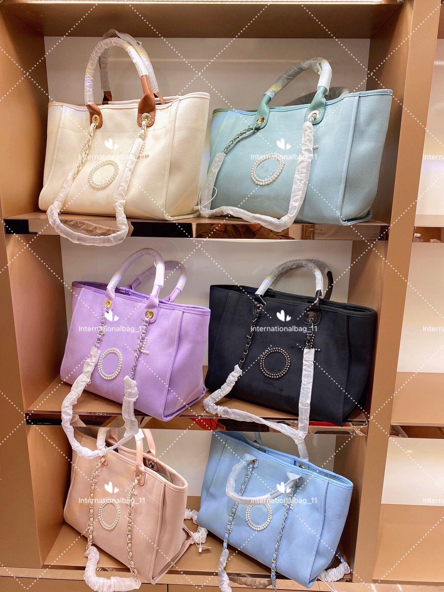 2021 Beach Beach Beach Designer Pearl Lady Canvas Shopping Bag Design Grande capacità Una spalla in sei colori