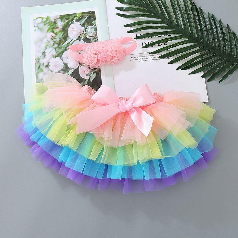 Baby Girls Tutuskirt Лук марлевые юбки дизайнер одежда детские девочки с повязкой PP короткое платье детские принцессы юбки детская одежда 0-3T 897 v2