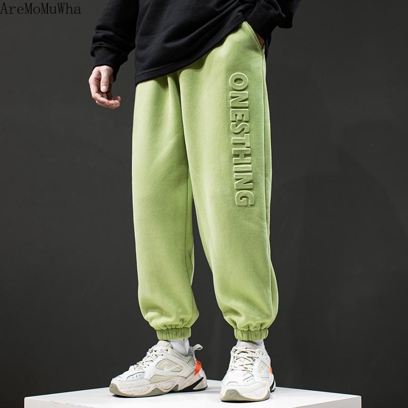 가을 겨울 제품 순수한 색상 캐주얼 스포츠 바지 남성 유행 브랜드 레트로 느슨한 플러스 벨벳 패딩 된 피트