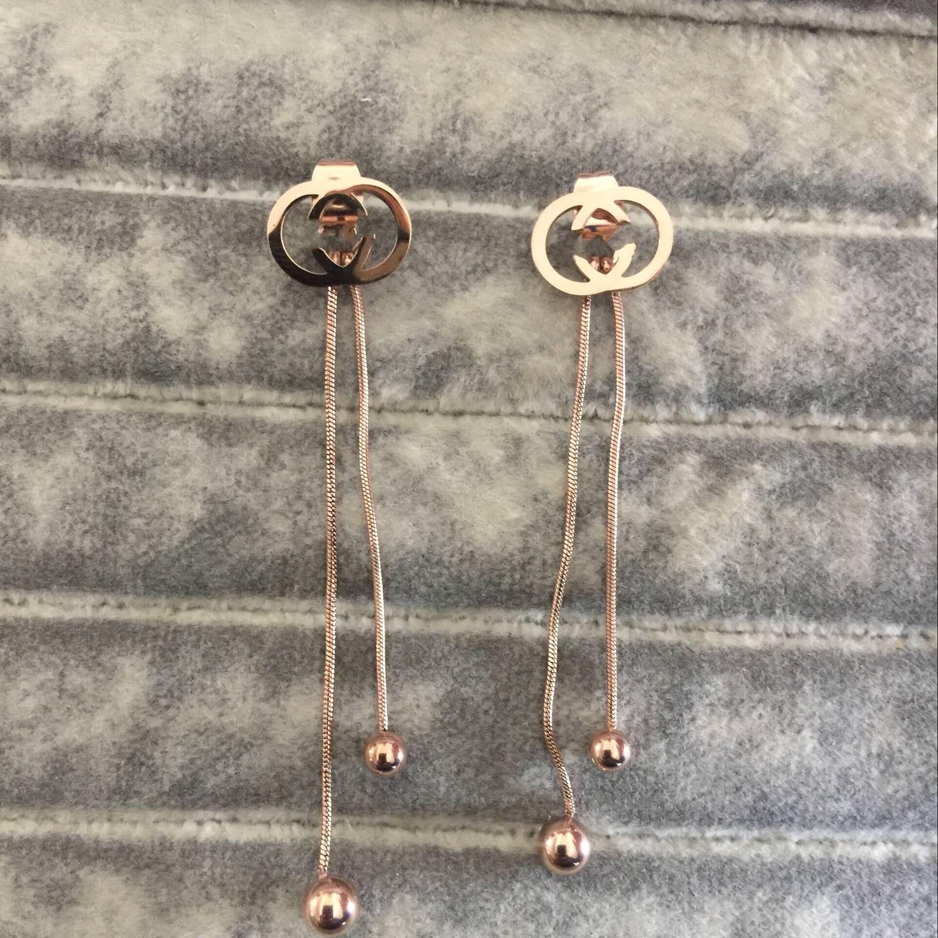 20 EE.UU. Design Mezcla al por mayor Exagerada Exagerada Grande Diamond Letra Tassel Drop Pendientes para niña Mujeres Rosa Oro Llena Amor Boda Bling Pendiente