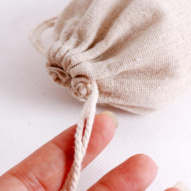 100 pçs / lote Natural cor sacos de algodão pequeno favores favores de linho saco de linho saco de presente musselina pulseira pulseira jewe jllqbj aquecedor 1358 v2