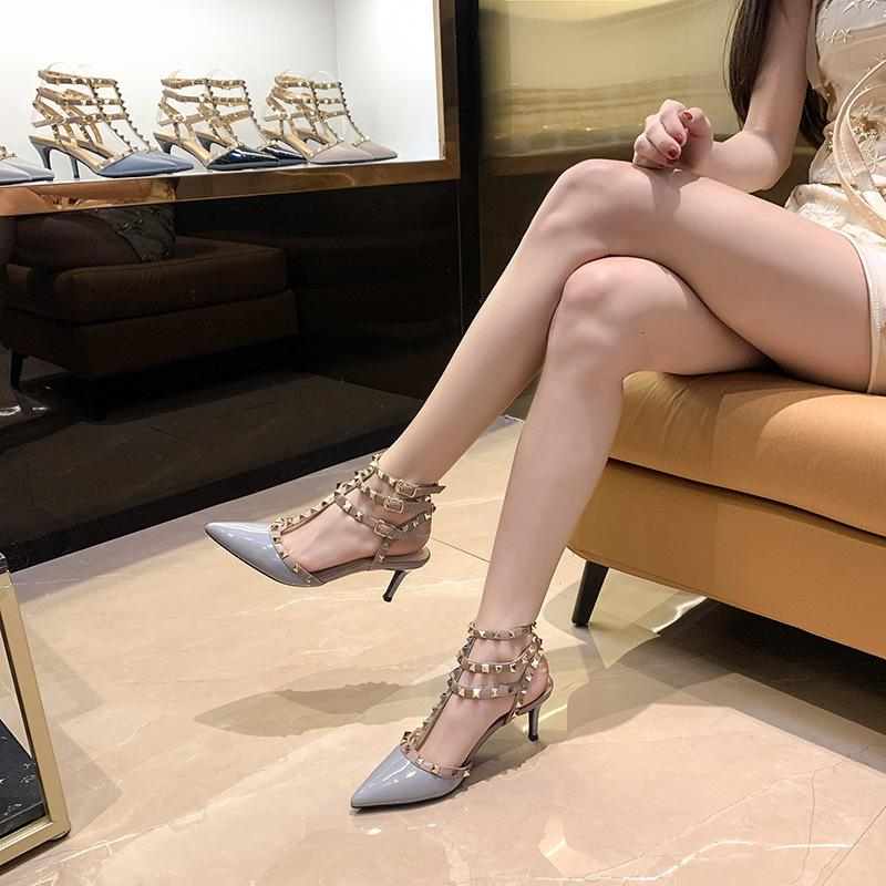 Luxury Dress Shoes Early Spring 2021 Pointed Rivet High-heeled Women's Thin Heels Versatile Wrap Head One-line Buckle Sandals Liuding Single Sho