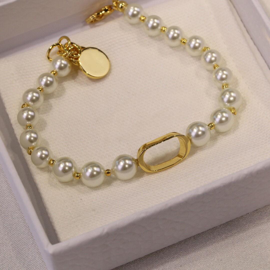 Luxurys Modedesigner Perlenarmband-Stränge ausgewählte hochwertige Materialien, die elegantes edles temperamentliegendes lässiges Kollo am Sehr schön zeigen
