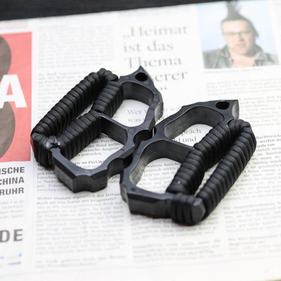 Fibra de vidrio Outdoor Finger Tiger Fist Hebilla Autodefensa Suministros legales Cuatro anillos gruesos PRUEBA DE MANO 23Y1702