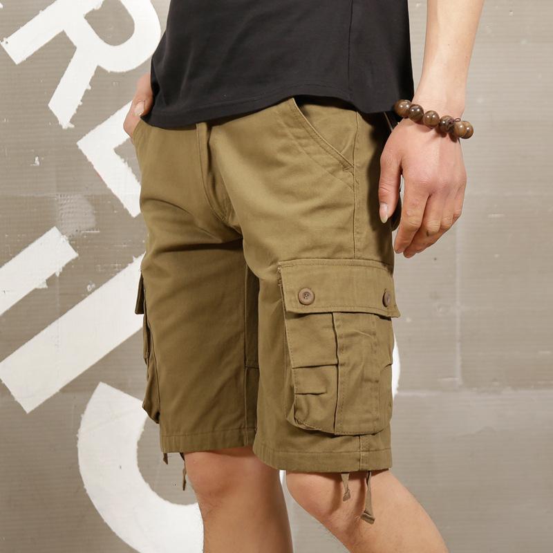 Pantalones cortos para hombres Multi verano pantalones cortos de bolsillos delgados para hombres jóvenes Tendencia suelta Capris Beach Pantalones casuales