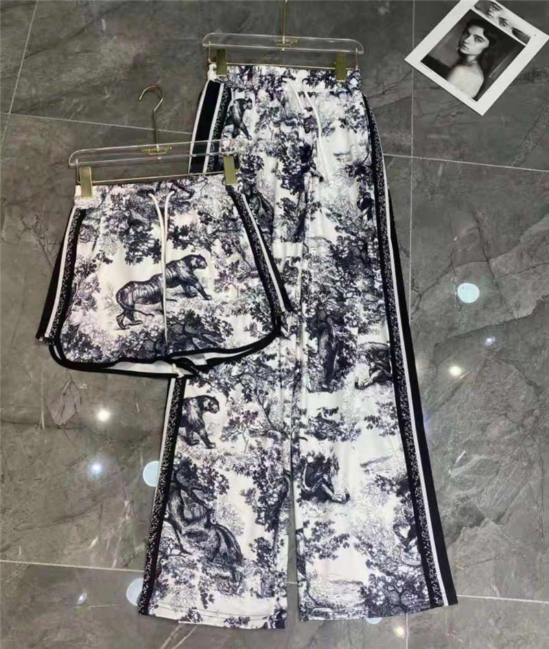 Mujeres Pantalones Pantalones Estilo de moda para la primavera Otoño Calle desgaste suelto Lady Capris Bottles Letras Lateral Impreso Tiger Pattern Trouse Pant Suéter Alta Calidad