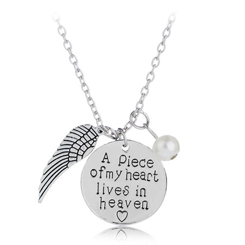 Parejas de moda collares collares de plata plateadas letras columpios un pedazo de mi corazón vive en el collar de gargantilla del cielo
