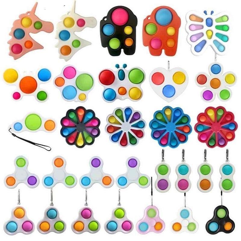 DHL 26 estilos dedo divertimento fidget bolha brinquedos empurrar covinha simples anel chave sensory espremo bolas bolhas keychain borboleta de flor unicórnio