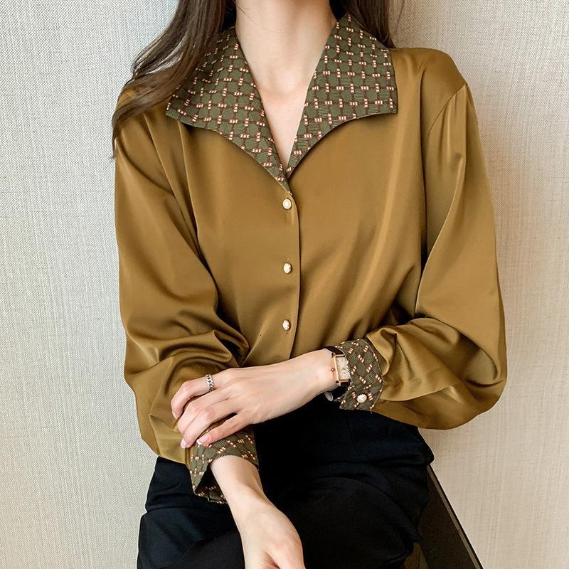 2021 Sentido de diseño de primavera de la moda, temperamento de sabor de Hong Kong, camisa de manga larga de la chiffona de la solapa del detapelo