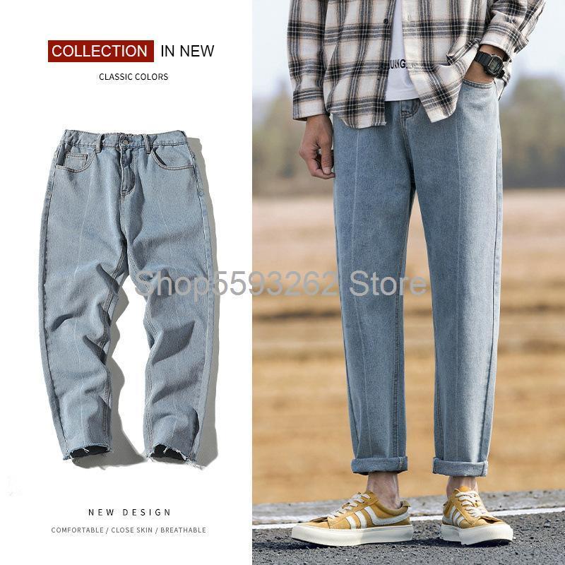I jeans uomini sciolti i pantaloni dritti si ribaltano semplici uomini casuali versatili