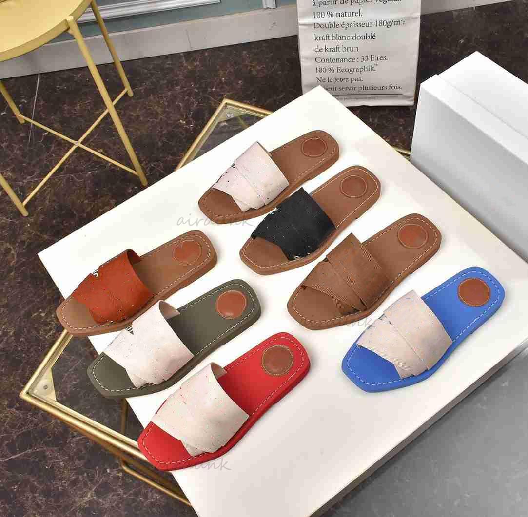 2021 Mulheres Mais Novas Mulheres Málias Mulas FFLAT Senhora Littering Tela Designer Canvas Cross Woven Sandálias Verão Outdoor Couro Sole Slide Letter Sapatos