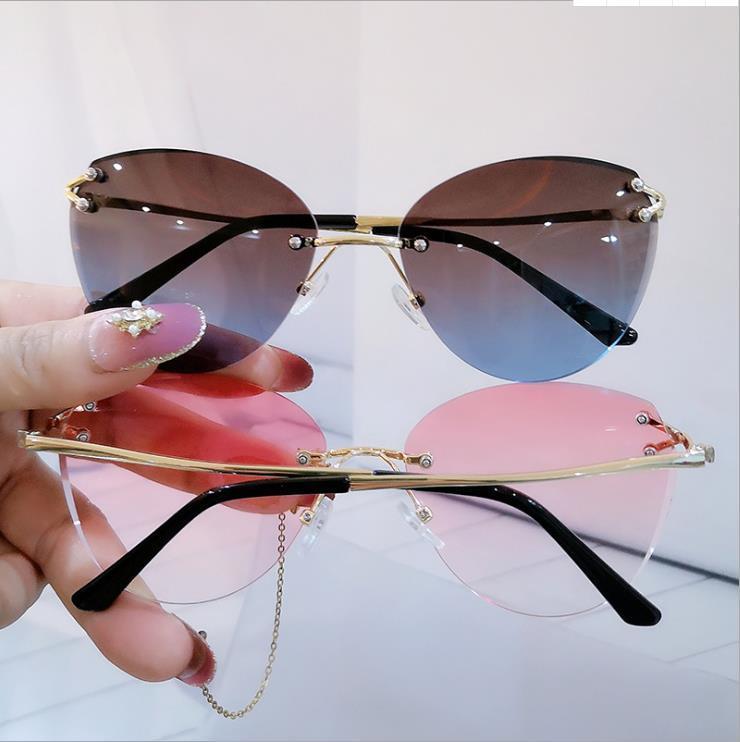 고전적인 바다 영화 고양이의 눈 개인화 선글라스 6 색 프레임리스 트리밍 패션 스트리트 사진 오목한 모양 여성 안경 자리 배달