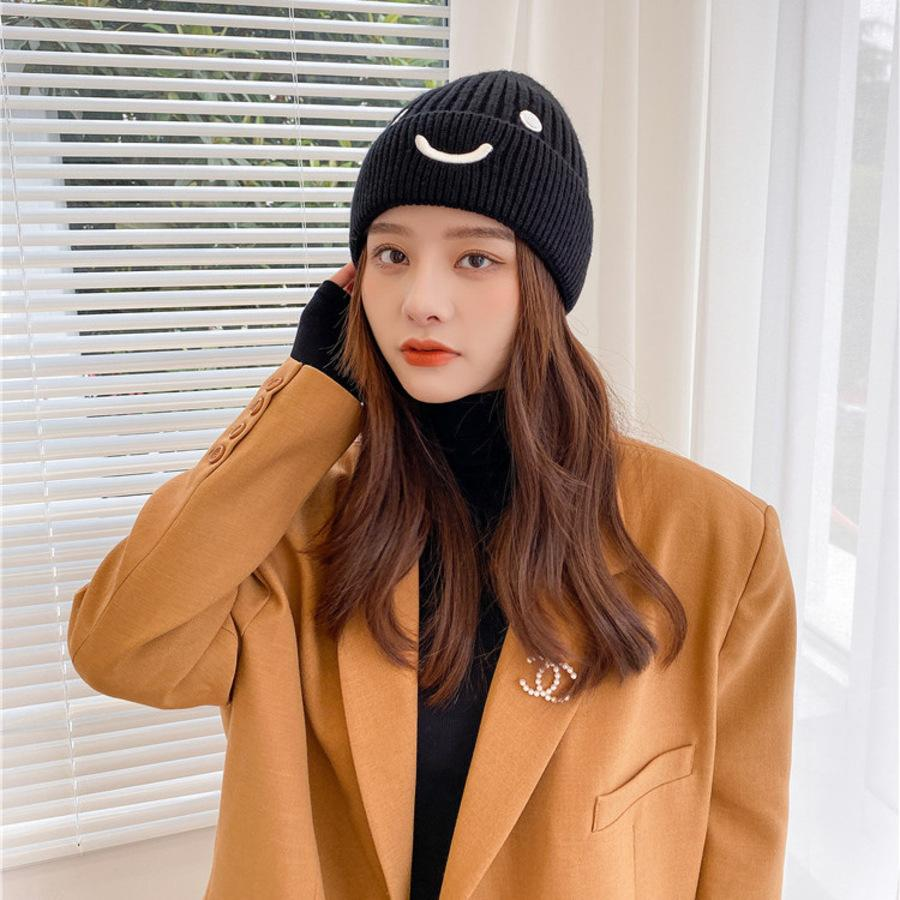 مضحك قبعة المرأة الخريف والشتاء الصوف الكورية الأزياء محبوك التعبير الباردة حزمة مبتسم الوجه PVHC