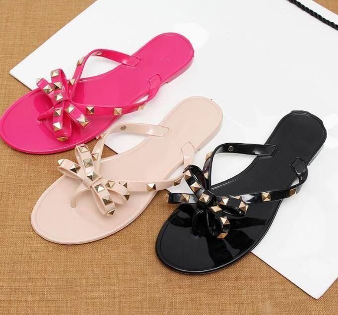 2021 Fashion Sexy Slippers Femminili Rivetto Big Bowknot Flat Cool Summer Beach Sandali Brand Jelly Girl Size 36- 41