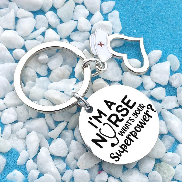 الفولاذ المقاوم للصدأ الممرضات المفاتيح أنا ممرضة جولة كيرينغ طالب الطبية هدية مجوهرات التبعي 25MM مفتاح سلسلة