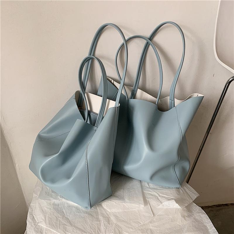여성을위한 큰 가방 2021 봄과 여름 한국 스타일 어깨 대용량 간단한 토트 학생 핸드 헬드 여성 크로스 바디