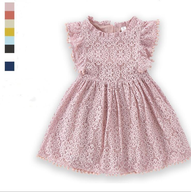 Enfants Designer Vêtements Girls Dentelle Dentelle Pompon Robes Fly Sleeve Hollow Out Robe Partie Princesse Sundresse Pour Printemps Automne Boutique Vêtements YL313