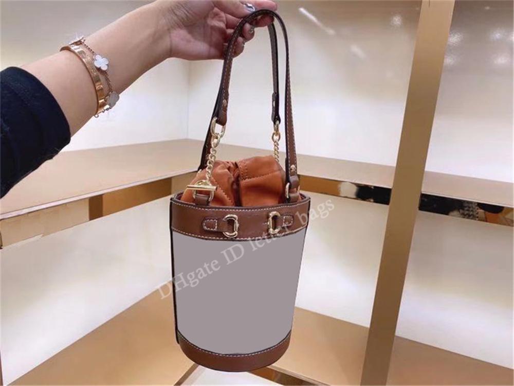 Дизайн Роскошная сумка 2021 Знаменитый дизайнер Ретро Женщины Мода Буква Холст Высокое Качество Аппаратное обеспечение Строка Двойной Ручкой Ведро Сумки Классические Тумба