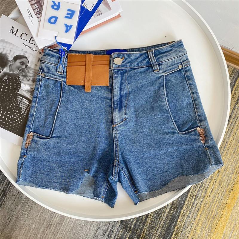 Pantalones cortos de daño Jeans Mujeres 1 Corte irregular de alta calidad Denim de cintura alta