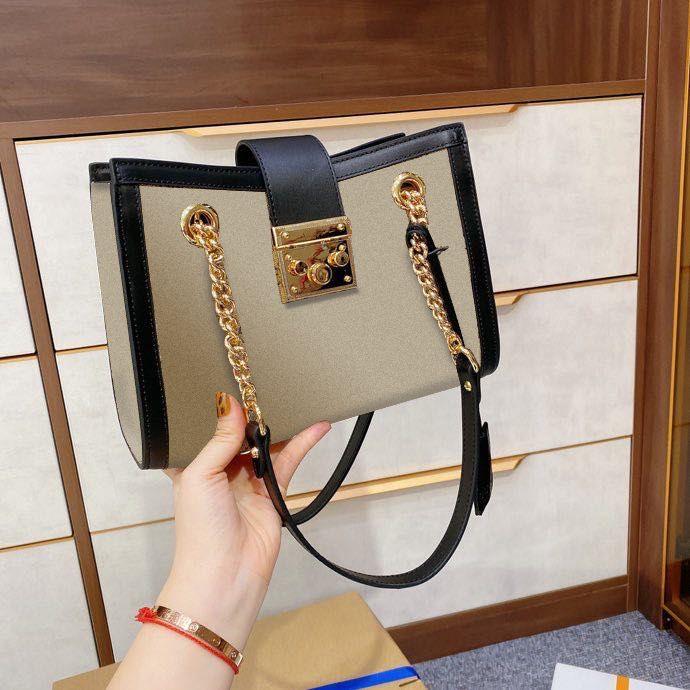 2021 مصمم حمل النساء حقائب الكتف قفل مع سلسلة قفل مربع قماش جلد طبيعي القوس المشارب الحقيقة الأزياء حقيبة