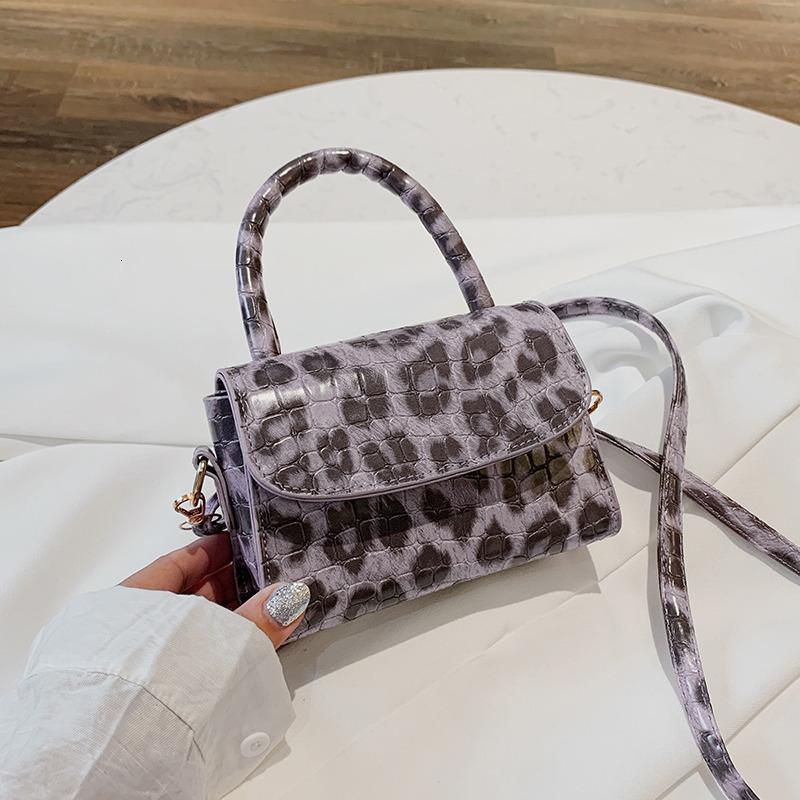 Billetera de moda portátil pequeña bolsa cuadrada otoño e invierno patrón de leopardo inclinador de la cruz de las mujeres