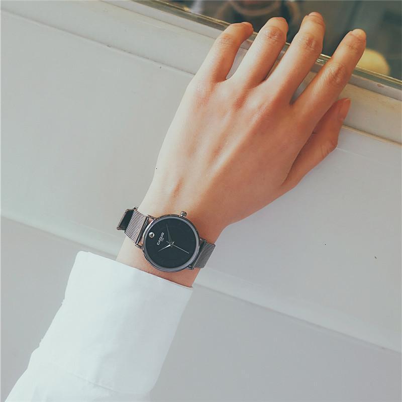 Новые влюбленные Пара ультратонких кварц мужская мода стальной водонепроницаемый студент женские часы черный