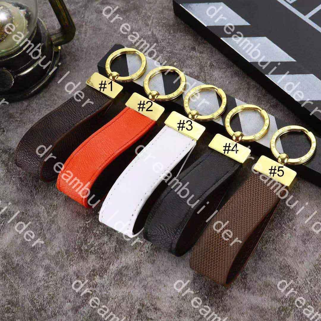 M65221 Correas de diseño de moda de lujo Hecho a mano PU Cuero Llavero Llavero Bolsa de mujeres Encanto Accesorios Colgantes