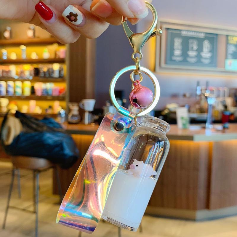أزياء جميلة الاتجاه العائمة الحليب خنزير قلادة الانجراف زجاجة الرمل في سلسلة مفتاح خنزير النفط