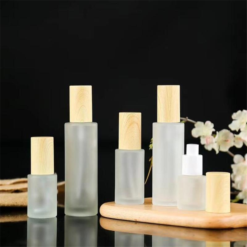 Frosted szklany krem do butelki jar balsam pompy butelki do refilowania zbiornik kosmetyczny 20 ml 30 ml 40 ml 80 ml 100 ml z imitowaną pokrywką z drewna