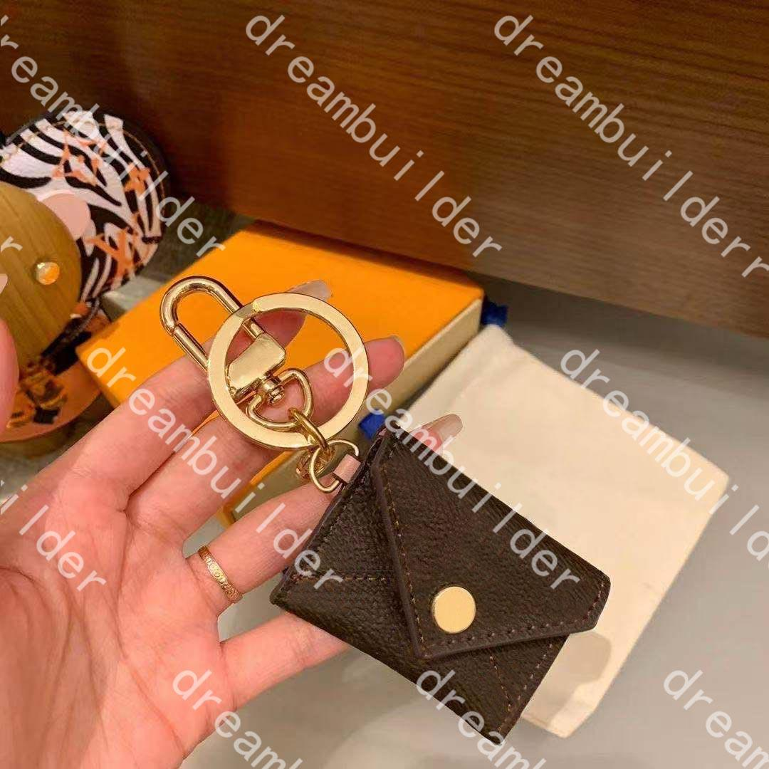 Moda de alta calidad M69003 Fashion Top Designer Llavero Hecho a mano PU Cuero Tarjeta de la tarjeta Coche Llaveros Hombre Mujer Bolsa Charm Decoración Colgante Accesorios Colgantes con caja