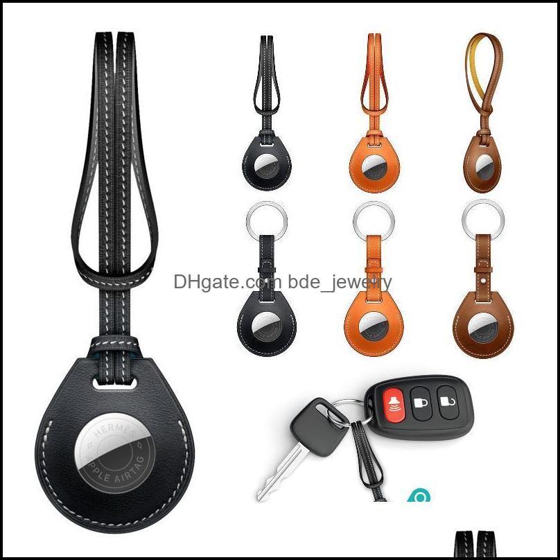Keychains Mode AESSORESORATS Coque de protection de la peau en cuir PU pour Traqueur Airtags avec porte-clés en métal Anti-Lost Apsories