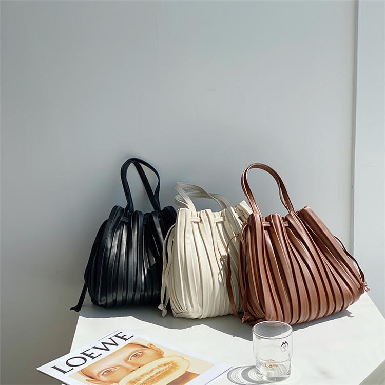 Luxurys designers classiques Toteries pour femmes imprimés à fleurs en relief sacs à main de sacs à bagages de voyage Sac à bagages shopping bandoulière