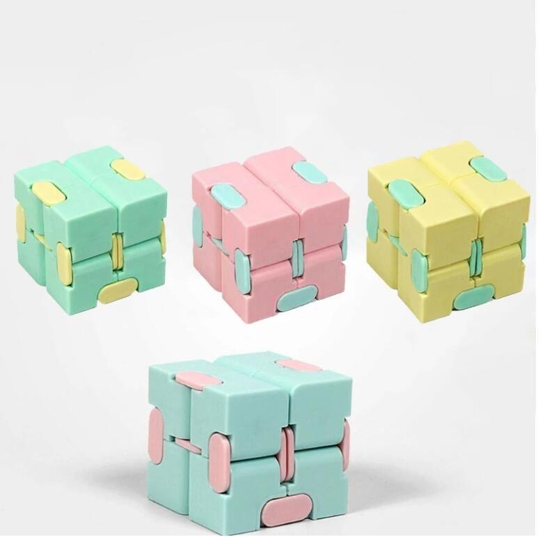 Bambini adulti Decompressione giocattolo Makaron Cube Square Puzzle Alleviare lo stress Funny Hand Game Four Corner Maze Toys
