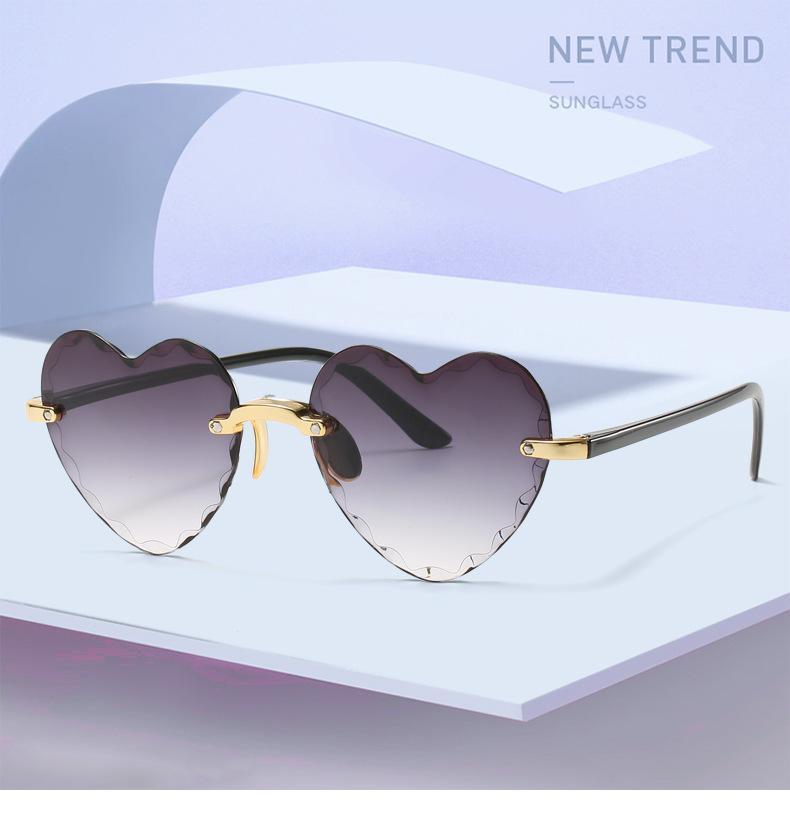 Damas en forma de corazón Gafas de sol Metal Mujeres Brand Designer Moda Rimless Gradiente Gafas de sol Oculos UV400