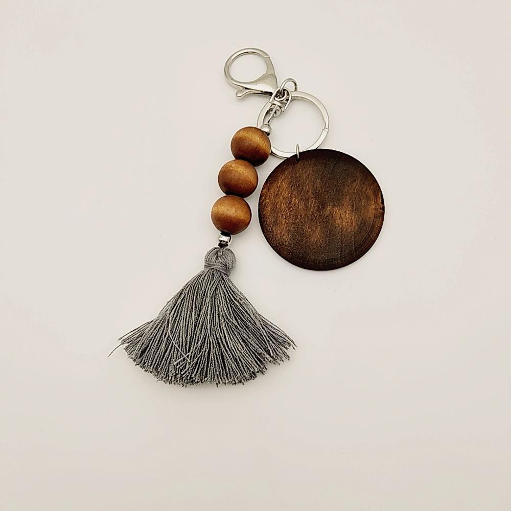 Hölzerne Perlen-Schlüsselanhänger-Party-Favor-Handel Holzperlen Schlüsselanhänger können Rund- und Baumwoll-Quaste-Anhänger Keychain ood6263 drucken