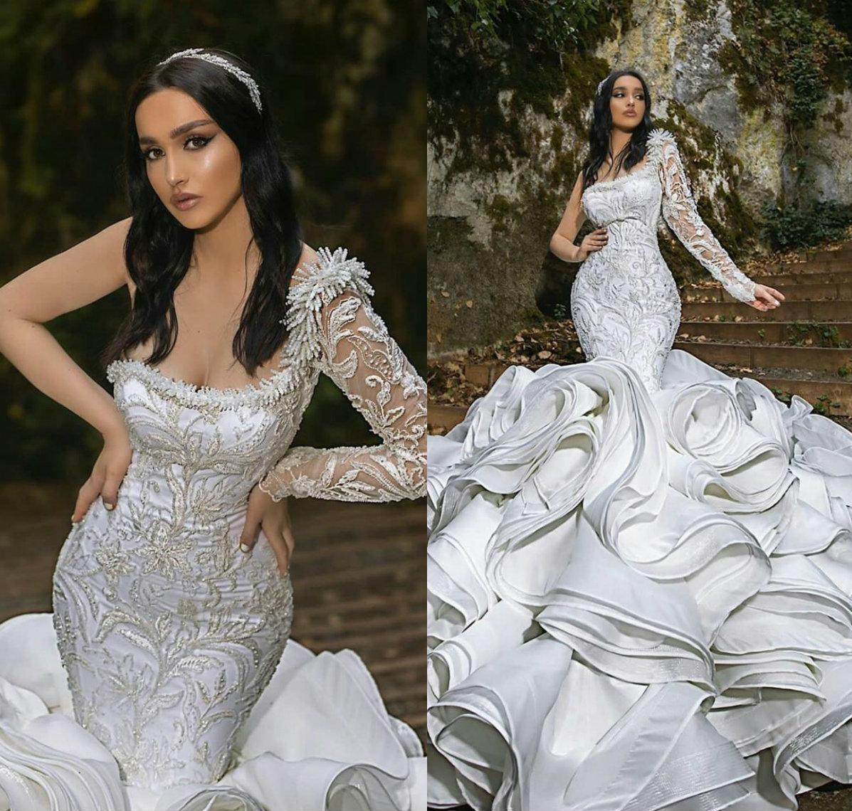 2021 Amazing Saudi Arabic Mermaid Bridal Gowns Long Sleeves Major Beading One Shoulder Church Wedding Dresses Ruffles Court Train Lace Vestidos Dubai Arabia AL8909
