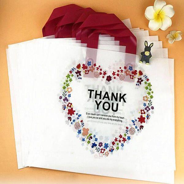Saco de compras de plástico branco com portador de punho obrigado coração flor impressão boutique empacotamento atacado