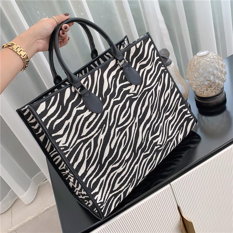 Große Kapazität Zebra-Tasche Frauen 2021 Temperament Tragbare Atmosphärische Schulter-Tote-Kreuzkörper